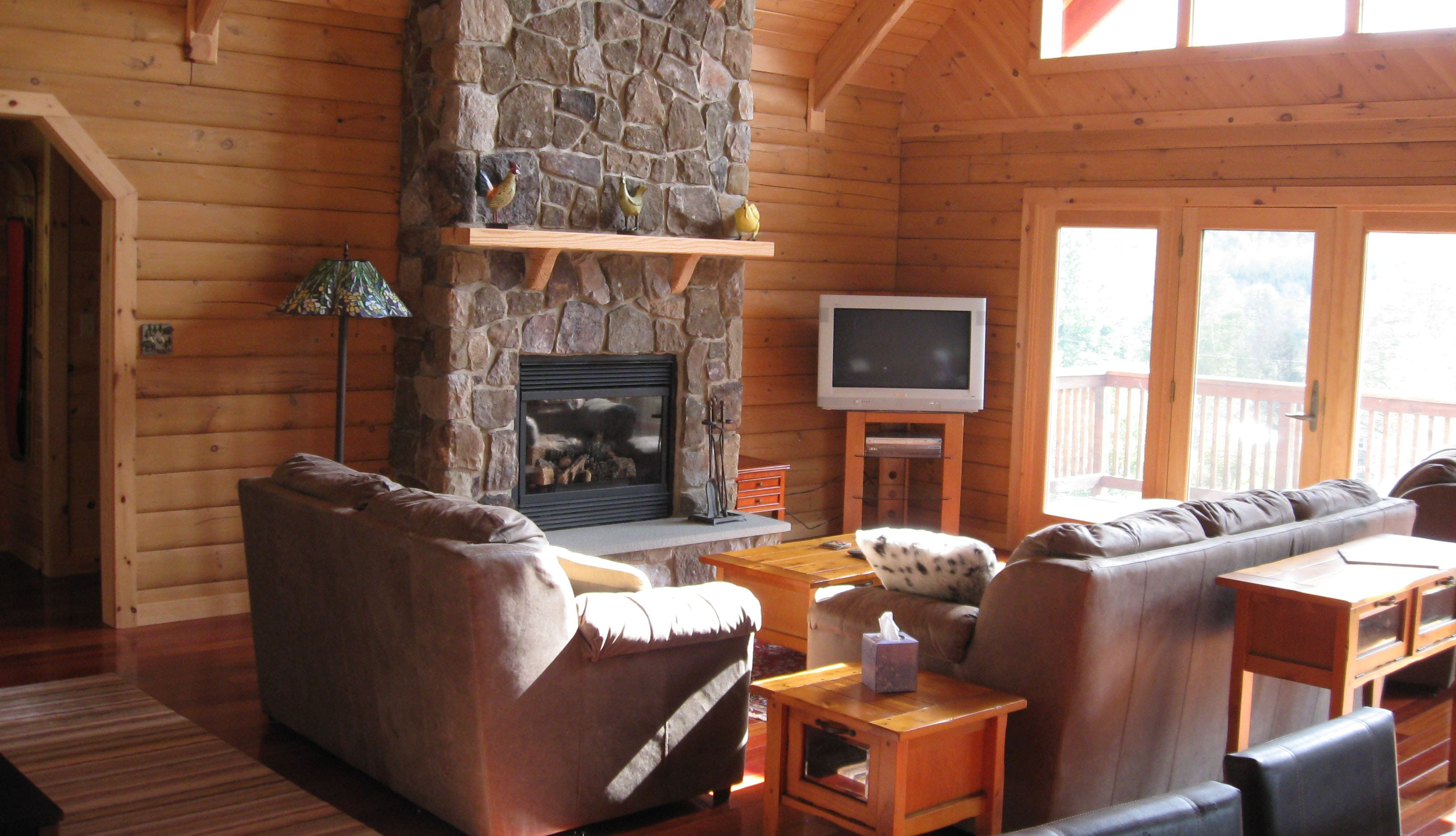 Comfy living room with French Doors to deck. Gas fireplace and TV.